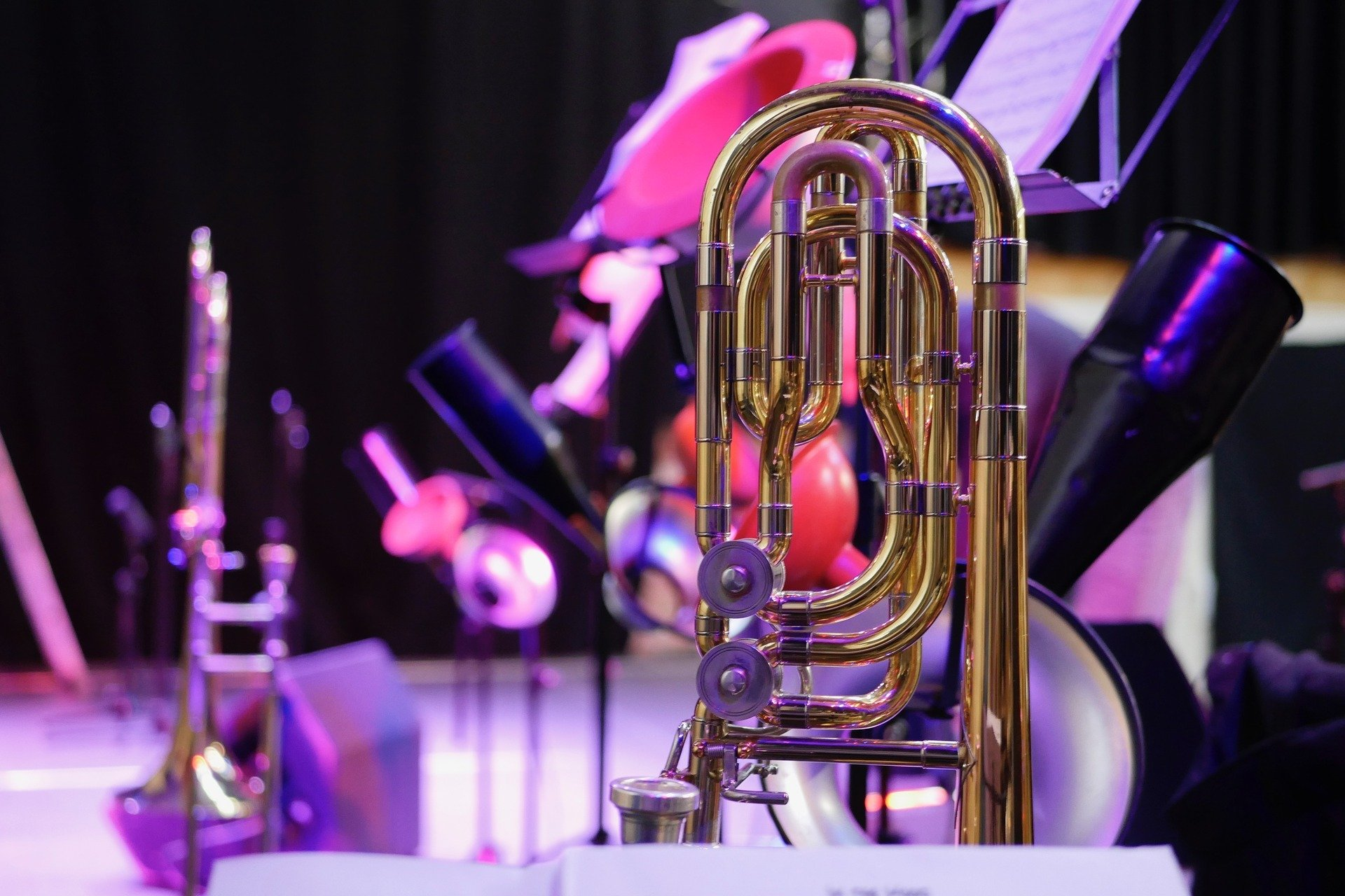 trombone in front of other musical instruments